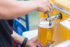 Draft beer dispenser. In party or pub Stock Images