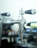 Draft beer pump tap in bar Stock Photo