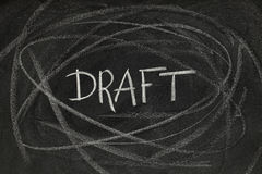 Draft headline on blackboard Stock Images