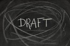 Draft headline on blackboard Stock Images