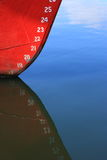 Draft Marks. On the bow of an ocean-going vessel reflected in calm waters stock image