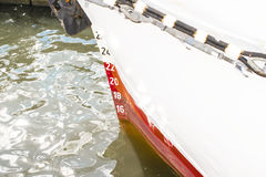 Draft marks on a ship`s bow, waterline stock image