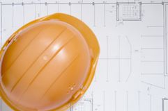 Draft papers and hard hat royalty free stock photography