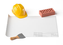 Draft project, helmet and brick on white  background Stock Photography