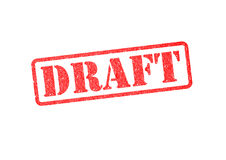 DRAFT. `DRAFT` red rubber stamp over a white background Royalty Free Stock Image
