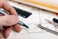 Drafting. Hand with pen and drafting equipment royalty free stock photos