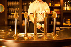 Drafting a beer in restaurant Stock Photos