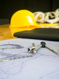 Drafting compass and rulers on blueprints. royalty free stock image
