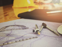 Drafting compass and rulers on blueprints. stock photos