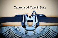 Drafting terms and conditions of an agreement using a retro typewriter stock image