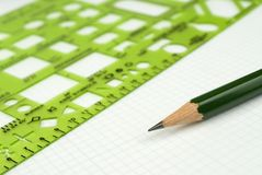 Drafting Tools. Pencil and rule on drafting paper royalty free stock photography