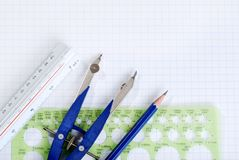Drafting tools on graph paper Royalty Free Stock Photos