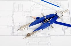 Drafting tools on house layout drawing. Closeup of drafting tools on house layout drawing Royalty Free Stock Image