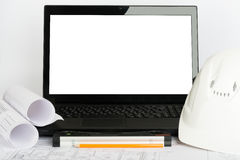 Drafts and laptop with blank screen Royalty Free Stock Photo