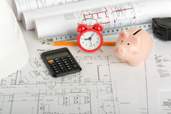 Drafts with piggy bank. Calculator and yellow pencil Royalty Free Stock Photography