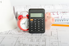 Drafts with piggy bank, close up view. Drafts with piggy bank, calculator and yellow pencil, close up view Stock Images