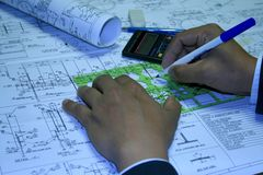 Draftsman. The engineering drawing on a paper. Ruler. Pencil royalty free stock images