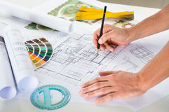 Draftsman Drawing Plan On Blueprint Stock Images