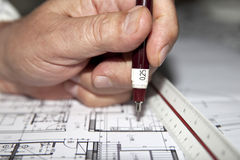 Draftsman Hand. Draftsman drawing house architecture plans Stock Photography