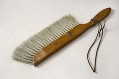 Draftsman`s broom on a textured paper. Draftsman`s broom tool isolated on a textured paper stock photos