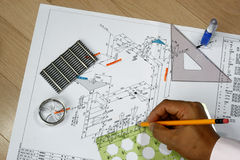 Draftsman at work. With his tools design plan and pencil-piping and instrument diagram royalty free stock images