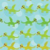 Dragão verde engraçado com as asas no fundo azul Imagem de Stock Royalty Free