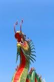 Dragón en el cielo azul Imagen de archivo