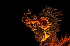 Dragón exótico del oro en fondo negro del cielo Imagen de archivo libre de regalías