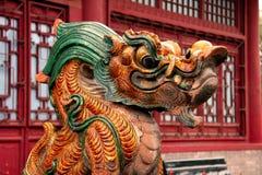 Dragón que se sienta 1 del esmalte Foto de archivo