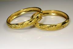 Dragón y pulsera de oro de Phoenix Foto de archivo libre de regalías