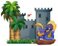 Dragón y un castillo Imagen de archivo