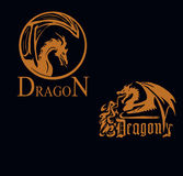 Dragões dourados em um fundo preto Foto de Stock Royalty Free