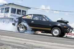 Drag car in action at the starting line Stock Images