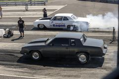 Drag car competitors on the track. Side view of two drag car competitors on the track making a start during the john scotti all out, august 20 2016 Stock Images