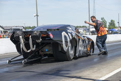 Drag car crewman. NHRA National Open July 12–13-14, 2015, picture of drag car and crewman giving directive in approach to the starting line Stock Image
