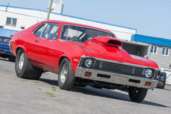 Drag car. Picture of red chevrolet nova ready for drag race - Classic american car turned into a hot rod Royalty Free Stock Image