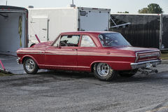 Drag car. Sanair september 1, 2014 picture of red chevrolet chevy drag car parked along the trailer at nostalgia drag racing event Stock Photos