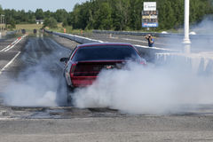Drag car smoke show Royalty Free Stock Image