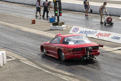 Drag racing. Picture of the red drag car in preparation at the starting line stock photography