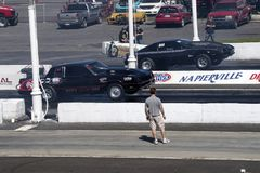 Drag cars in action at the starting line Royalty Free Stock Images