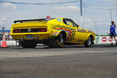 Drag racing. Napierville dragway, canada - june 7, 2014 picture of 1972 yellow mustang fastback drag car during staff directive at head up challenge event Stock Photo