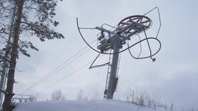 Drag lift, ski lift, twisting mechanism lifts around. Rope tow at a ski resort. Mechanism yoke. 4K.  stock video footage