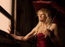 Drag Queen in an asylum. Pensive Drag Queen in an asylum Royalty Free Stock Photography