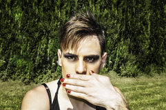 Drag queen covering her mouth Royalty Free Stock Photo