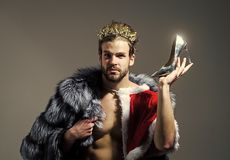 Drag queen, homosexual and trans. Freak, gay and transvestite. Cinderella prince with shoe on grey background. Freedom and lgbt, kitsch. Christmas guy in santa stock photos