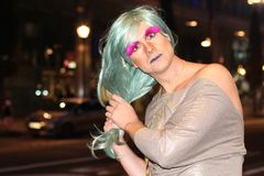 Drag queen looking  at camera outdoors stock images