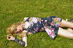 Drag queen lying on grass Royalty Free Stock Image