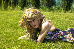 Drag queen lying on grass and looking Royalty Free Stock Photography