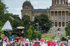 A Drag Queen and other participants in parade - Capitol behind. Participants walk in the parade with the Iowa State Capitol behind Stock Image