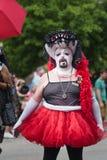 A Drag Queen participates in Gay Pride Parade. A man dressed in drag participates in Des Moines' Gay Pride Parade 2015 stock photos